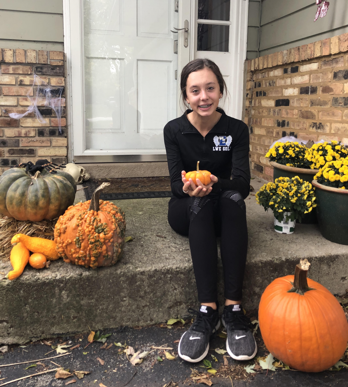Freshman Jessica Jarosik posing with her Halloween Pumpkins